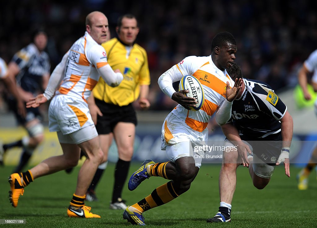 Christian Wade of London Wasps races clear before going over for a try during the Aviva Premiership match between Sale Sharks and London Wasps at the Salford City Stadium on May 04, 2013 in Salford, England.