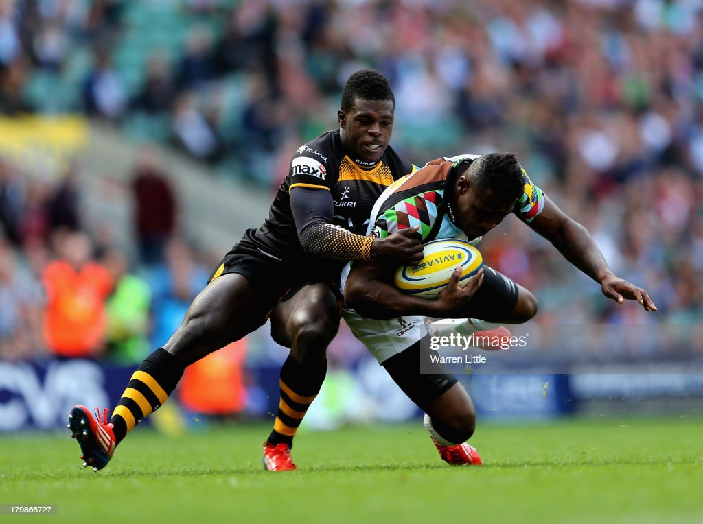 <a gi-track='captionPersonalityLinkClicked' href=/galleries/search?phrase=Christian+Wade&family=editorial&specificpeople=4948108 ng-click='$event.stopPropagation()'>Christian Wade</a> of London Wasps tackled <a gi-track='captionPersonalityLinkClicked' href=/galleries/search?phrase=Ugo+Monye&family=editorial&specificpeople=221264 ng-click='$event.stopPropagation()'>Ugo Monye</a> of Harlequins during the Aviva Premiership match between London Wasps and Harlequins at Twickenham Stadium on September 7, 2013 in London, England.