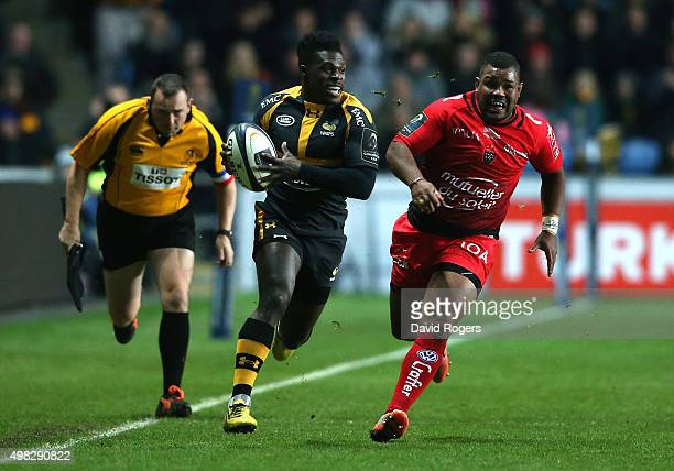Christian Wade of Wasps breaks clear of Steffon Armitage during the European Rugby Champions Cup match between Wasps and Toulon at the Ricoh Arena on...