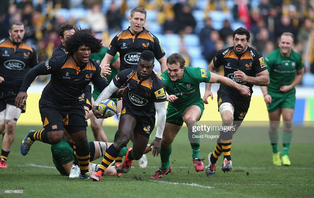 <a gi-track='captionPersonalityLinkClicked' href=/galleries/search?phrase=Christian+Wade&family=editorial&specificpeople=4948108 ng-click='$event.stopPropagation()'>Christian Wade</a> of Wasps breaks clear with the ball to set up a try for <a gi-track='captionPersonalityLinkClicked' href=/galleries/search?phrase=Joe+Simpson+-+Rugby+Union+Player&family=editorial&specificpeople=15126852 ng-click='$event.stopPropagation()'>Joe Simpson</a> during the Aviva Premiership match between Wasps and London Irish at the Ricoh Arena on December 21, 2014 in Coventry, England.