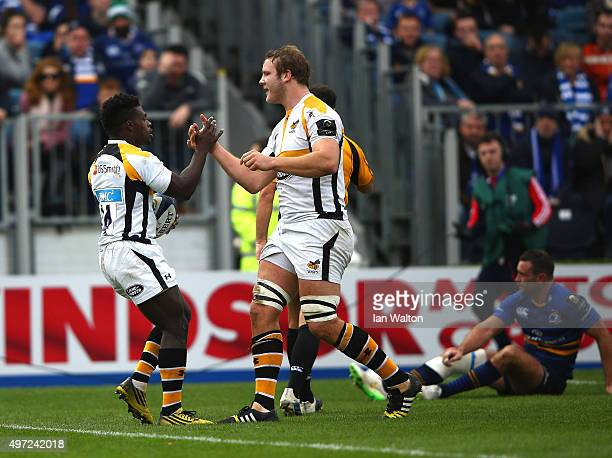 Christian Wade of Wasps celebrates scoring a try with Joe Launchbury during the European Rugby Champions Cup match between Leinster Rugby and Wasps...