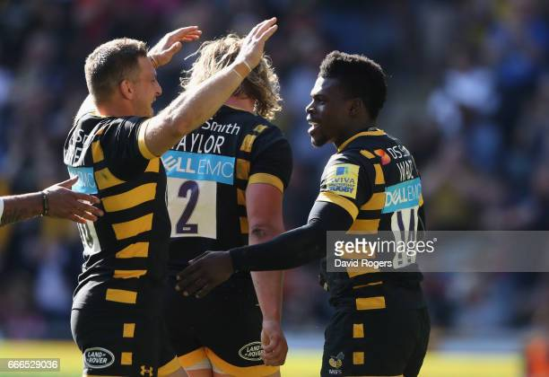 Christian Wade of Wasps celebrates with team mate Jimmy Gopperth after scoring a try during the Aviva Premiership match between Wasps and Northampton...