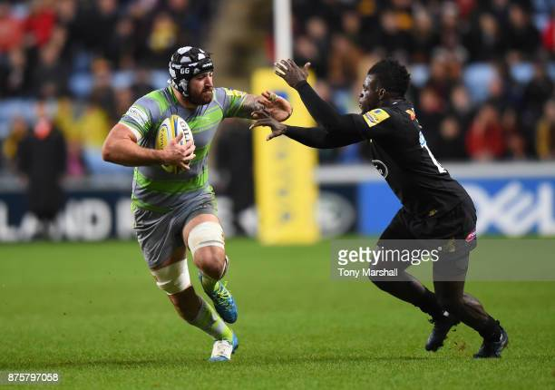 Christian Wade of Wasps is held off by Gary Graham of Newcastle Falcons during the Aviva Premiership match between Wasps and Newcastle Falcons at The...