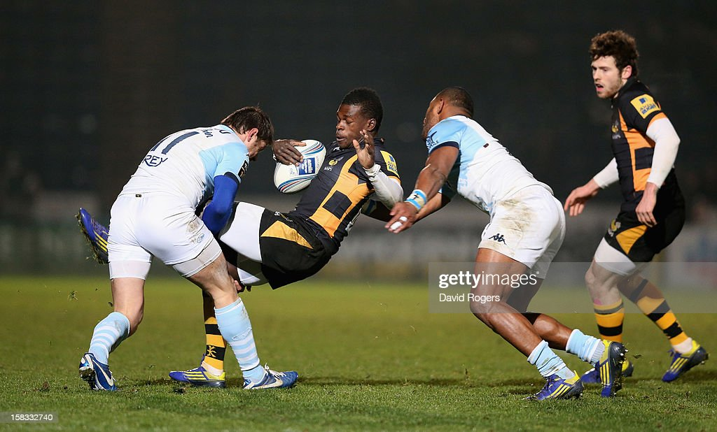 Christian Wade of Wasps is tackled by Cedric Heymans and Joe Rokocoko during the Amlin Challenge Cup match between London Wasps and Bayonne at Adams...