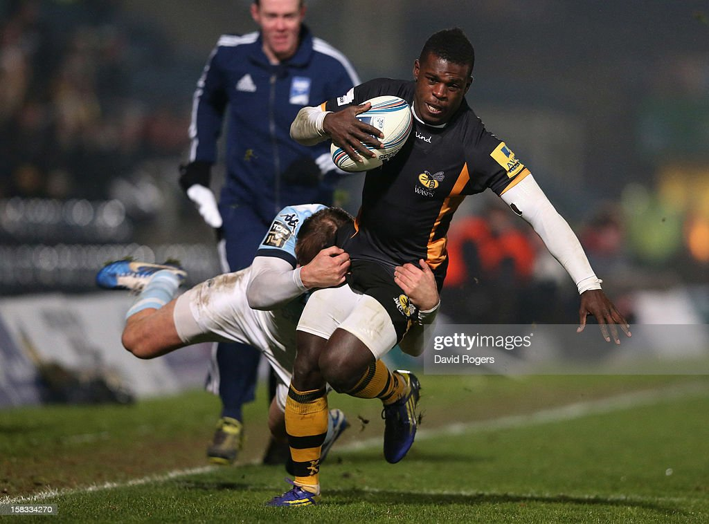 <a gi-track='captionPersonalityLinkClicked' href=/galleries/search?phrase=Christian+Wade&family=editorial&specificpeople=4948108 ng-click='$event.stopPropagation()'>Christian Wade</a> of Wasps is tackled by Cedric Heymans during the Amlin Challenge Cup match between London Wasps and Bayonne at Adams Park on December 13, 2012 in High Wycombe, England.