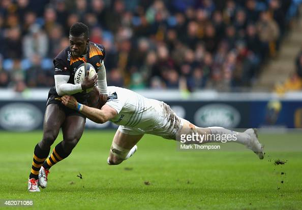 Christian Wade of Wasps is tackled by Jamie Heaslip of Leinster during the European Rugby Champions Cup game between Wasps and Leinster Rugby at The...