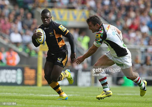 Christian Wade of Wasps races clear of George Lowe to score his second try during the Aviva Premiership match between London Wasps and Harlequins at...
