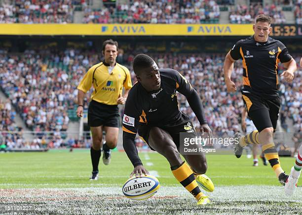 Christian Wade of Wasps races clear to score his second try during the Aviva Premiership match between London Wasps and Harlequins at Twickenham...