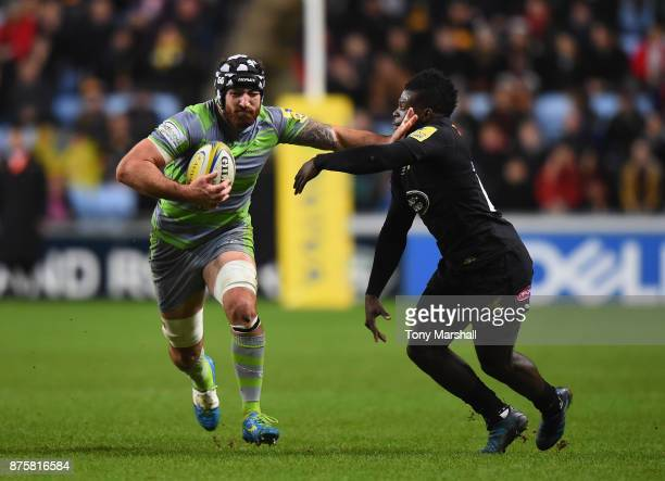 Christian Wade of Wasps tackle is held off by Gary Graham of Newcastle Falcons during the Aviva Premiership match between Wasps and Newcastle Falcons...