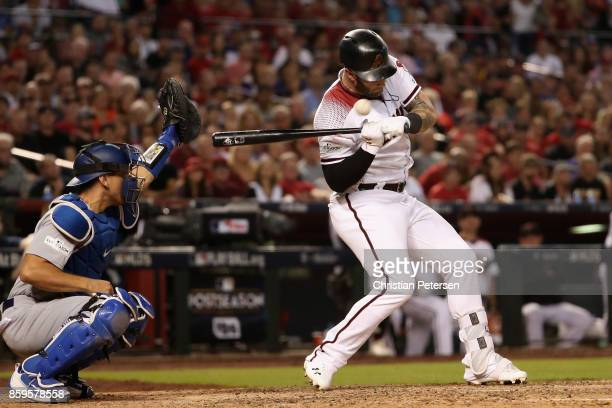 Christian Walker of the Arizona Diamondbacks is hit by a pitch during the sixth inning of the National League Divisional Series game three against...