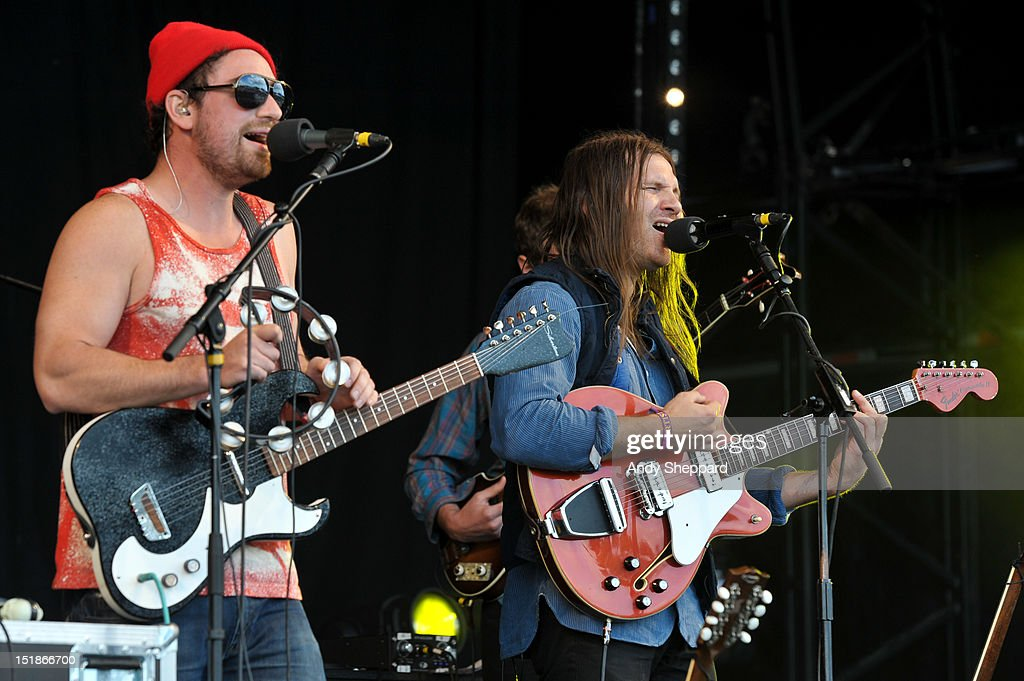 Christian Wargo (R) of the band Poor Moon performs on stage during End Of The Road Festival 2012 at Larmer Tree Gardens on August 31, 2012 in Salisbury, United Kingdom.