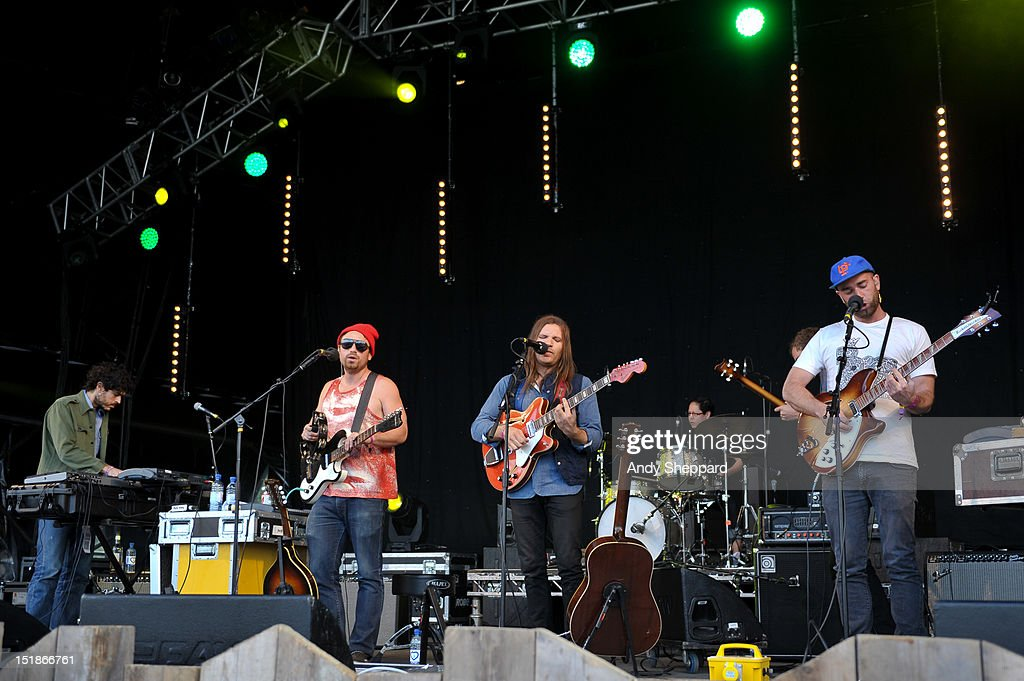 Christian Wargo (C) of the band Poor Moon performs on stage during End Of The Road Festival 2012 at Larmer Tree Gardens on August 31, 2012 in Salisbury, United Kingdom.