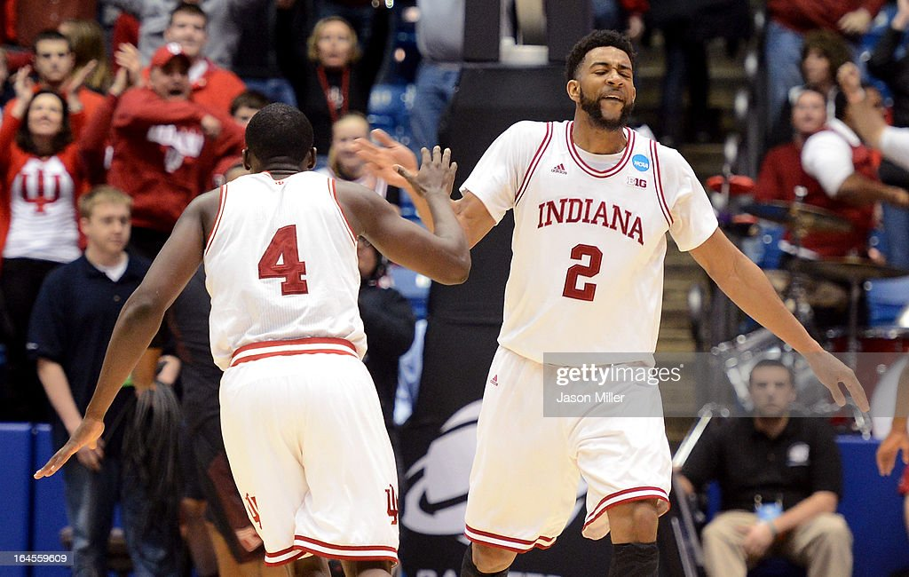 Christian Watford #2 and Victor Oladipo #4 of the Indiana Hoosiers celebrate late in the game against the Temple Owls during the third round of the 2013 NCAA Men's Basketball Tournament at UD Arena on March 24, 2013 in Dayton, Ohio.