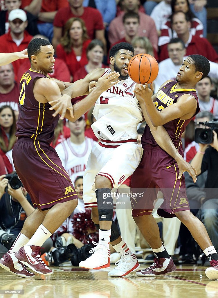 Christian Watford #2 of the Indiana Hoosiers and Joe Coleman #11 and Rodney Williams #33 of the Minnesota Golden Gophers reach for a loose ball during the game at Assembly Hall on January 12, 2013 in Bloomington, Indiana.