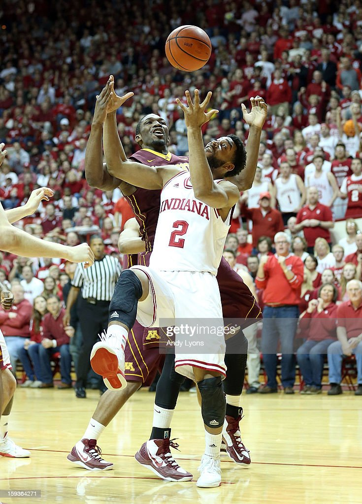 Christian Watford #2 of the Indiana Hoosiers and <a gi-track='captionPersonalityLinkClicked' href=/galleries/search?phrase=Trevor+Mbakwe&family=editorial&specificpeople=4898343 ng-click='$event.stopPropagation()'>Trevor Mbakwe</a> #32 of the Minnesota Golden Gophers reach for a loose ball during the game at Assembly Hall on January 12, 2013 in Bloomington, Indiana.