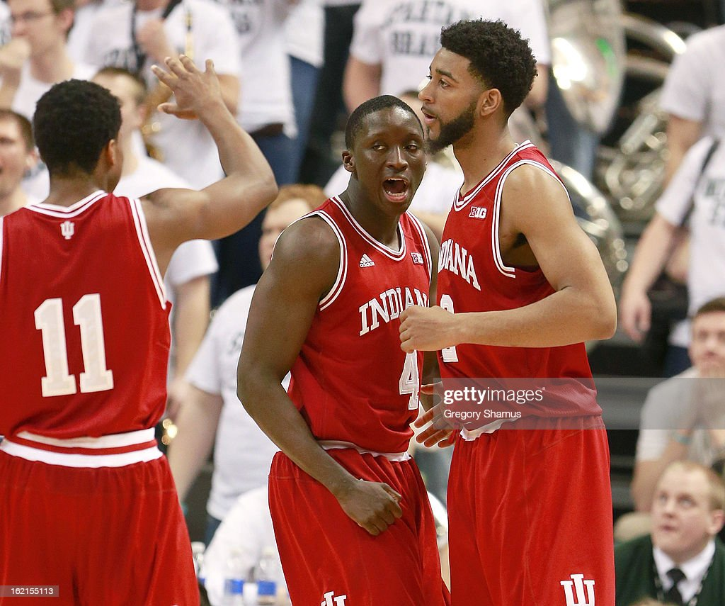 Christian Watford #2 of the Indiana Hoosiers celebrates a second half basket with <a gi-track='captionPersonalityLinkClicked' href=/galleries/search?phrase=Victor+Oladipo&family=editorial&specificpeople=6681560 ng-click='$event.stopPropagation()'>Victor Oladipo</a> #4 and Kevin Ferrell #11 while playing the Michigan State Spartans at the Jack T. Breslin Student Events Center on February 19, 2013 in East Lansing, Michigan. Indiana won the game 72-68.