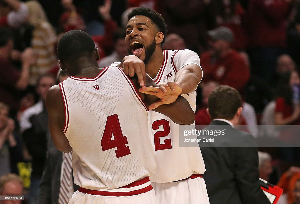Christian Watford #2 of the Indiana Hoosiers celebrates with teammate Victor Oladipo #4 after Oladipo dunked on the Illinois Fighting Illini during a quarterfinal game of the Big Ten Basketball Tournament at the United Center on March 15, 2013 in Chicago, Illinois. Indiana defeated Illinois 80-64.