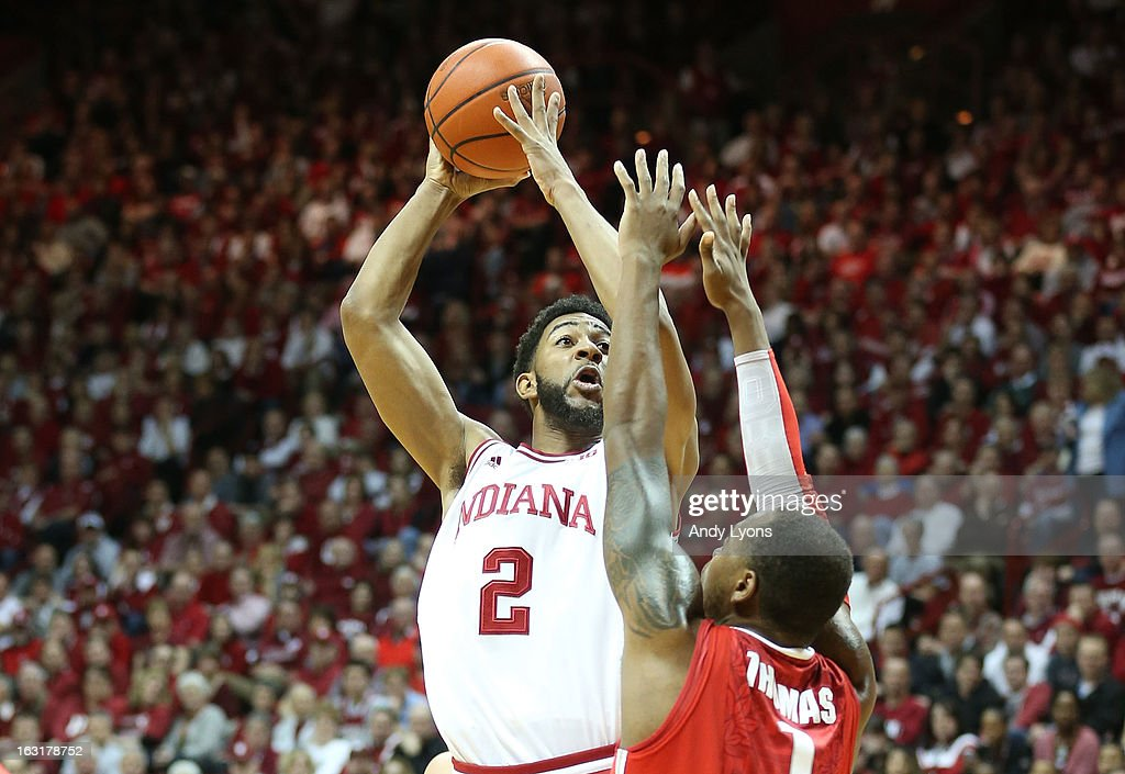 Christian Watford #2 of the Indiana Hoosiers shoots the ball while defended by Deshaun Thomas #1 of the Ohio State Buckeyes during the game at Assembly Hall on March 5, 2013 in Bloomington, Indiana.