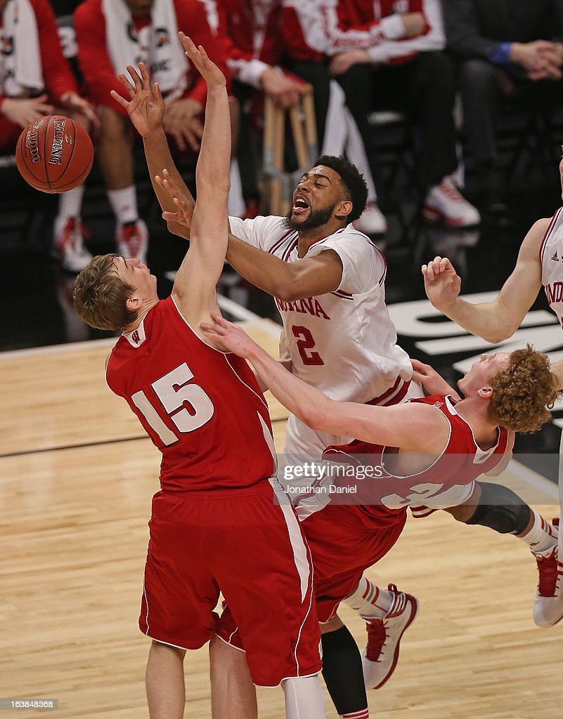 Christian Watford #2 of the Indiana Hoosiers tries to pass under pressure from San Dekker #15 and Mike Bruesewitz #31 of the Wisconsin Badgers during a semifinal game of the Big Ten Basketball Tournament at the United Center on March 16, 2013 in Chicago, Illinois.