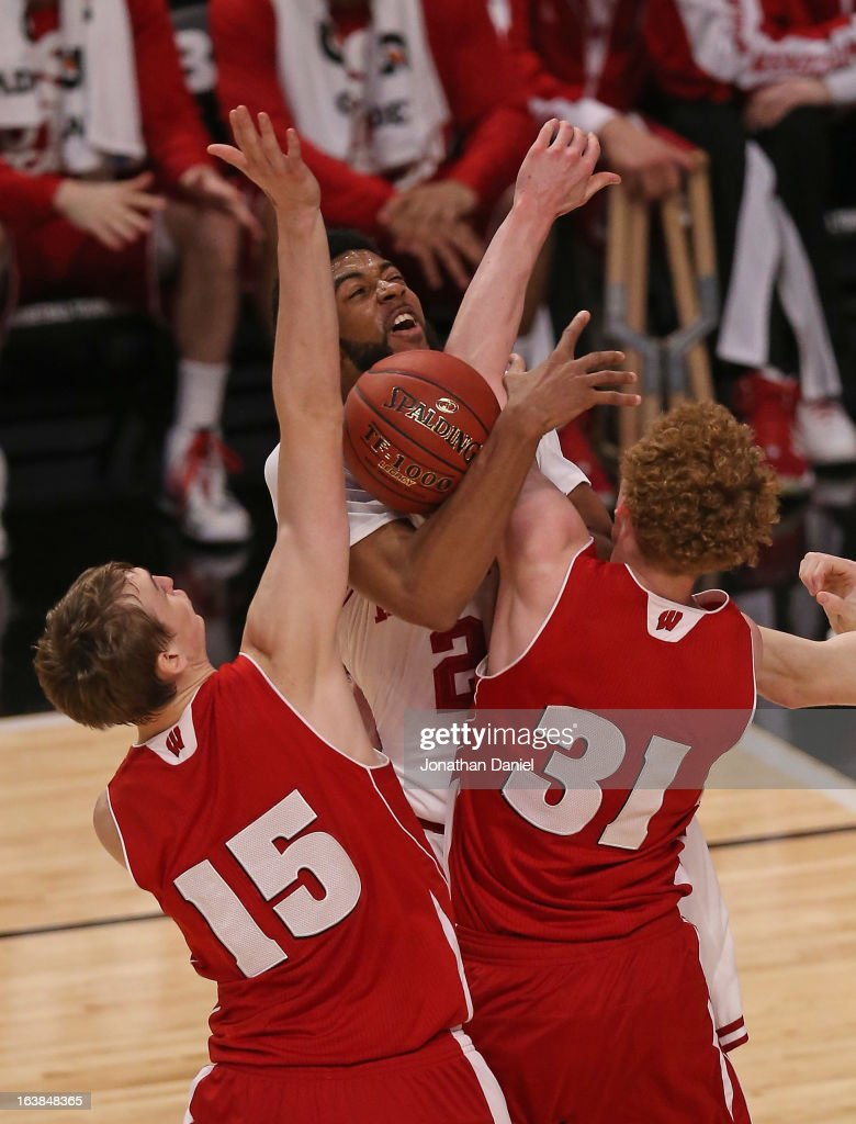 Christian Watford #2 of the Indiana Hoosiers tries to shoot under pressure from San Dekker #15 and Mike Bruesewitz #31 of the Wisconsin Badgers during a semifinal game of the Big Ten Basketball Tournament at the United Center on March 16, 2013 in Chicago, Illinois.