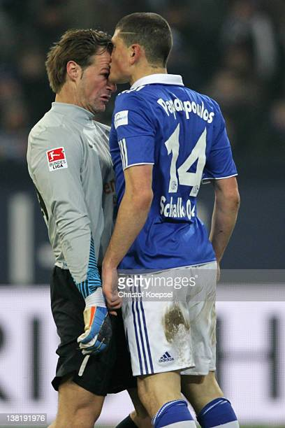 Christian Wetklo of Mainz and Kyriakos Papadopoulos of Schalke knock at each other during the Bundesliga match between FC Schalke 04 and FSV Mainz 05...