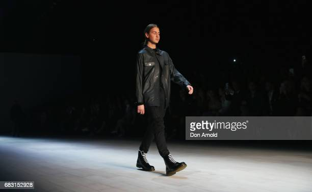 Christian Wilkins walks the runway during the Justin Cassin show at MercedesBenz Fashion Week Resort 18 Collections at Carriageworks on May 15 2017...