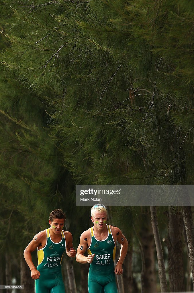 Christian Wilson and Matthew Baker of Australia compete in the Team Relay Triathlon during day four of the Australian Youth Olympic Festival at Sydney International Regatta Centre on January 19, 2013 in Sydney, Australia.