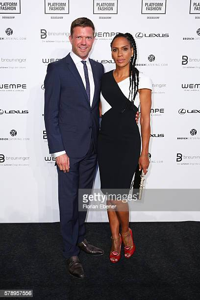 Christian Witt and Barbara Becker attend the Breuninger show during Platform Fashion July 2016 at Areal Boehler on July 22 2016 in Duesseldorf Germany
