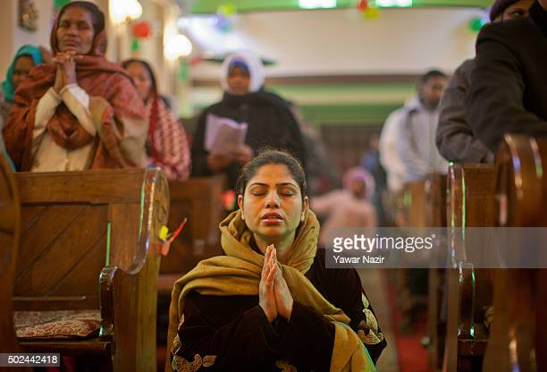 Christian woman prays in the Holy Family Catholic Church during a Christmas mass on December 25 2015 in Srinagar the summer capital of Indian...