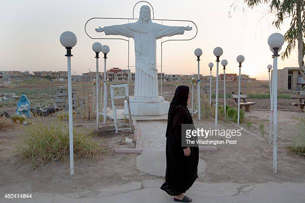 Christian woman takes an evening stroll on July 13 2014 The town of 50000 is one of the oldest Christian communities in Iraq