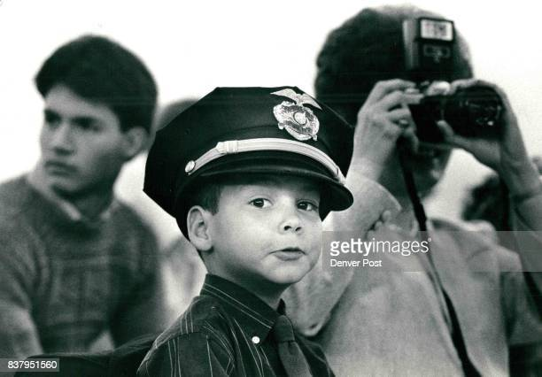 Christian Wood age 6 made a sharp impression during ceremonies promoting his father Dean Wood to seargent in the Denver Police Department Mr Wood has...