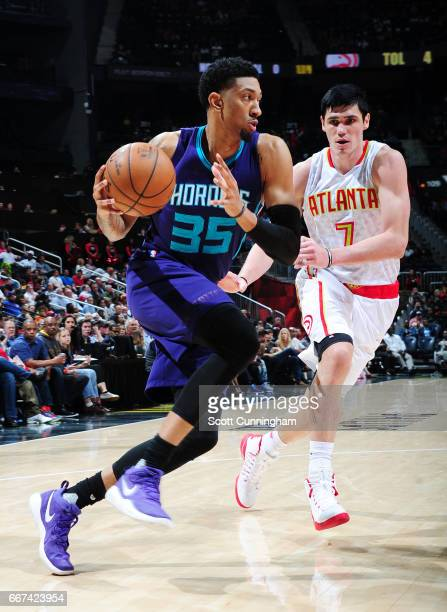 Christian Wood of the Charlotte Hornets handles the ball against Ersan Ilyasova of the Atlanta Hawks during the game on April 11 2017 at Philips...
