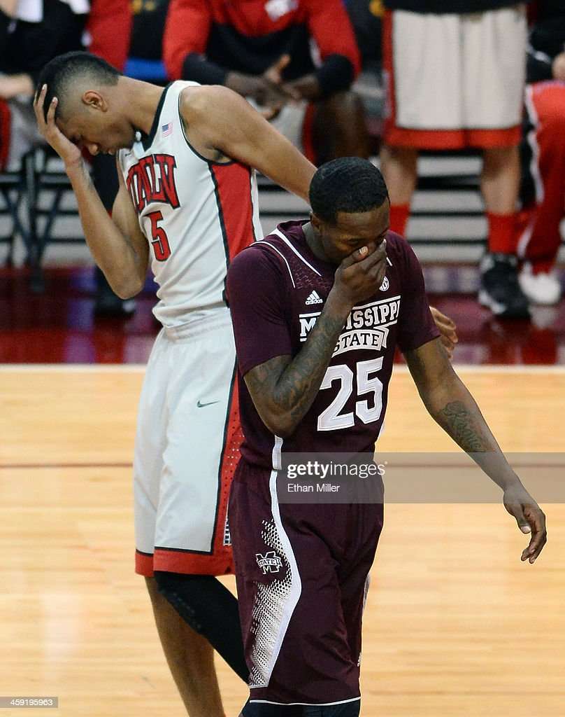Christian Wood #5 of the UNLV Rebels and Roquez Johnson #25 of the Mississippi State Bulldogs hold their heads after colliding during the 2013 Continental Tire Las Vegas Classic at the Orleans Arena on December 23, 2013 in Las Vegas, Nevada. UNLV won 82-66.