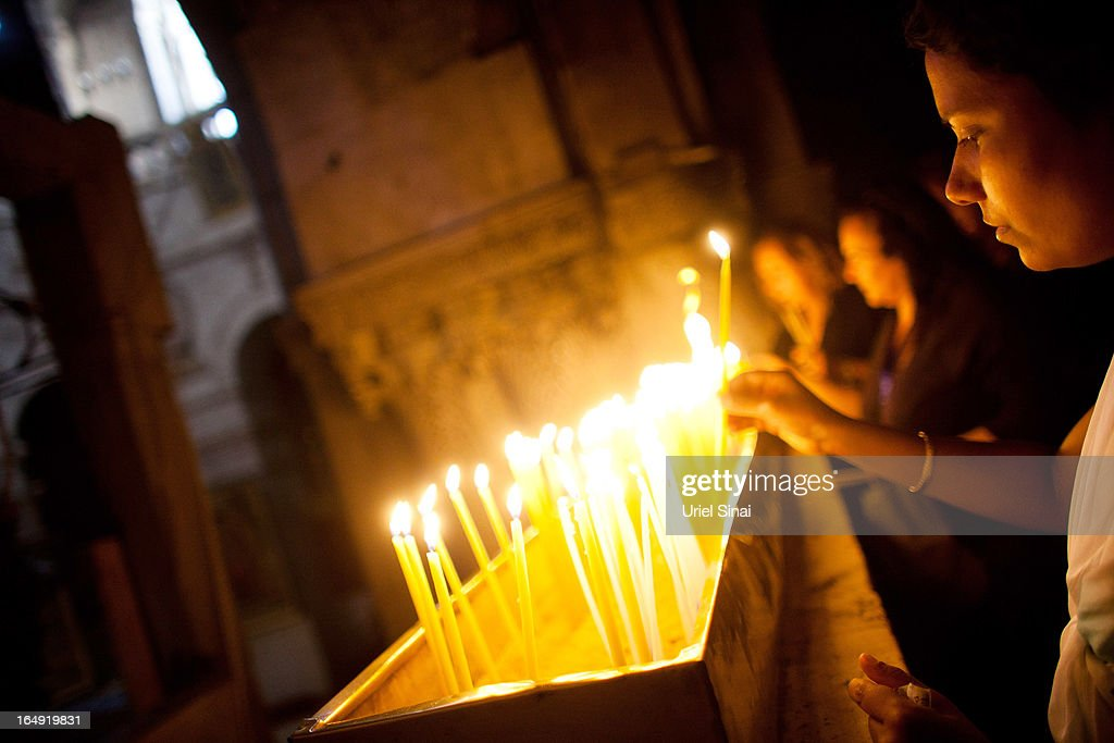 A Christian worshiper lights a candle at the Church of the Holy Sepulchre during the Good Friday on March 29, 2013 in Jerusalem's Old City, Israel. Good Friday is celebrated by Christians throughout the world as the day Christ was crucified on the cross in the lead up to his resurrection on Easter.