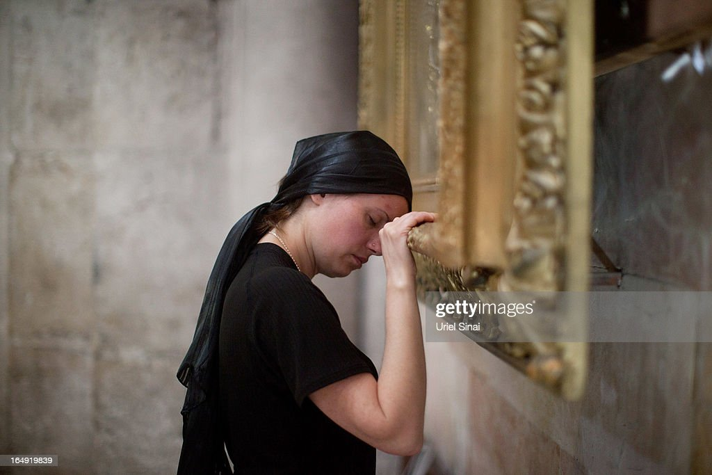 A Christian worshiper prays at the Church of the Holy Sepulchre during the Good Friday on March 29, 2013 in Jerusalem's Old City, Israel. Good Friday is celebrated by Christians throughout the world as the day Christ was crucified on the cross in the lead up to his resurrection on Easter.