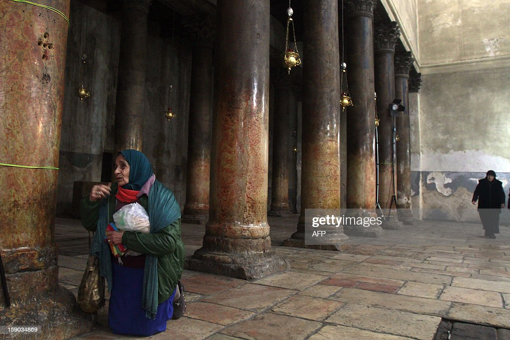 A Christian worshiper prays inside the Church of the Nativity as Orthodox Christmas celebrations kicked off on January 6, 2013, in the traditional birthplace of Jesus Christ in the West Bank town of Bethlehem.