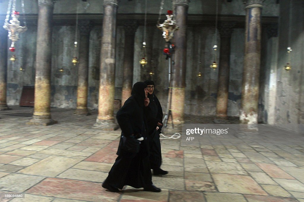 Christian worshiper walks inside the Church of the Nativity as Orthodox Christmas celebrations kicked off on January 6, 2013 in the traditional birthplace of Jesus Christ in the West Bank town of Bethlehem.