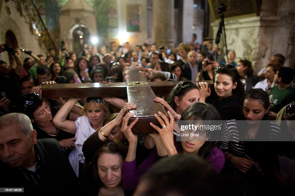 Christian worshipers carry a large wooden cross at the Church of the Holy Sepulchre during the Good Friday procession on March 29, 2013 in Jerusalem's Old City, Israel. Good Friday is celebrated by Christians throughout the world as the day Christ was crucified on the cross in the lead up to his resurrection on Easter.
