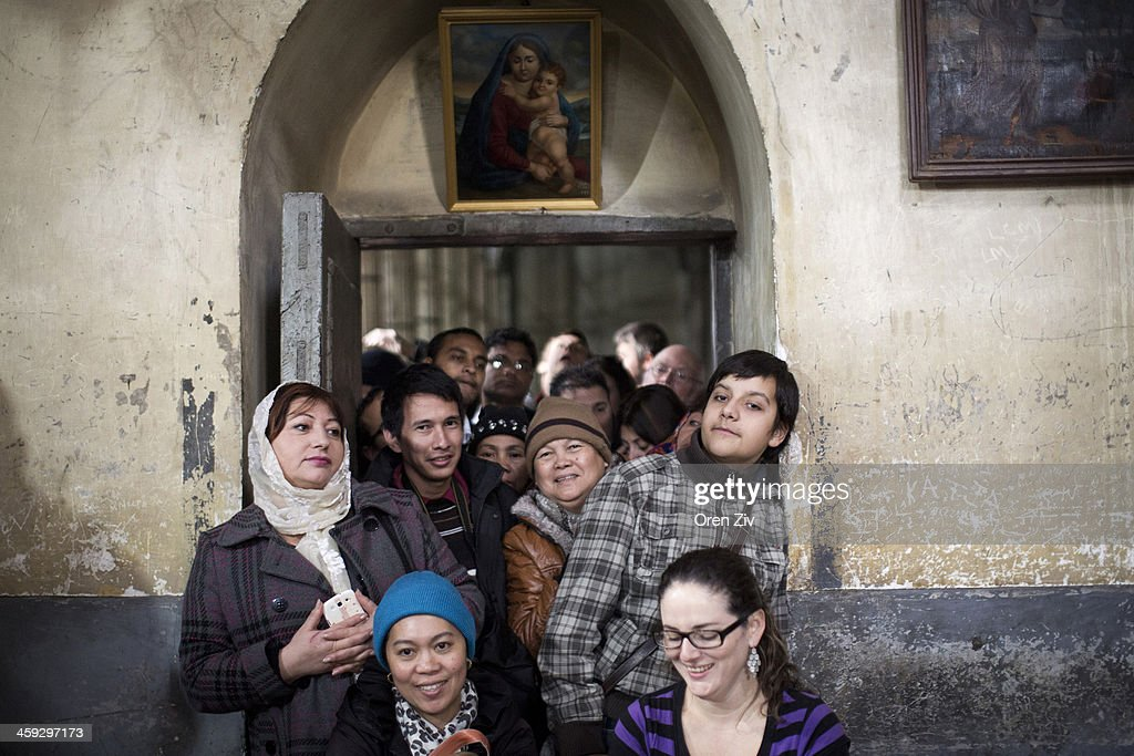 Christian worshipers wait in line during the Christmas mass at the Church of the Nativity, traditionally believed to be the birthplace of Jesus Christ, on December 25, 2013 in Bethlehem, West Bank. Every Christmas pilgrims travel to the church where a gold star embedded in the floor marks the spot where Jesus was believed to have been born.