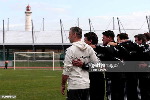 Christian Wuck coach and the staff of Germany sing the anthem during the UEFA Under16 match between U16 France v U16 Germany on February 6 2016 in...