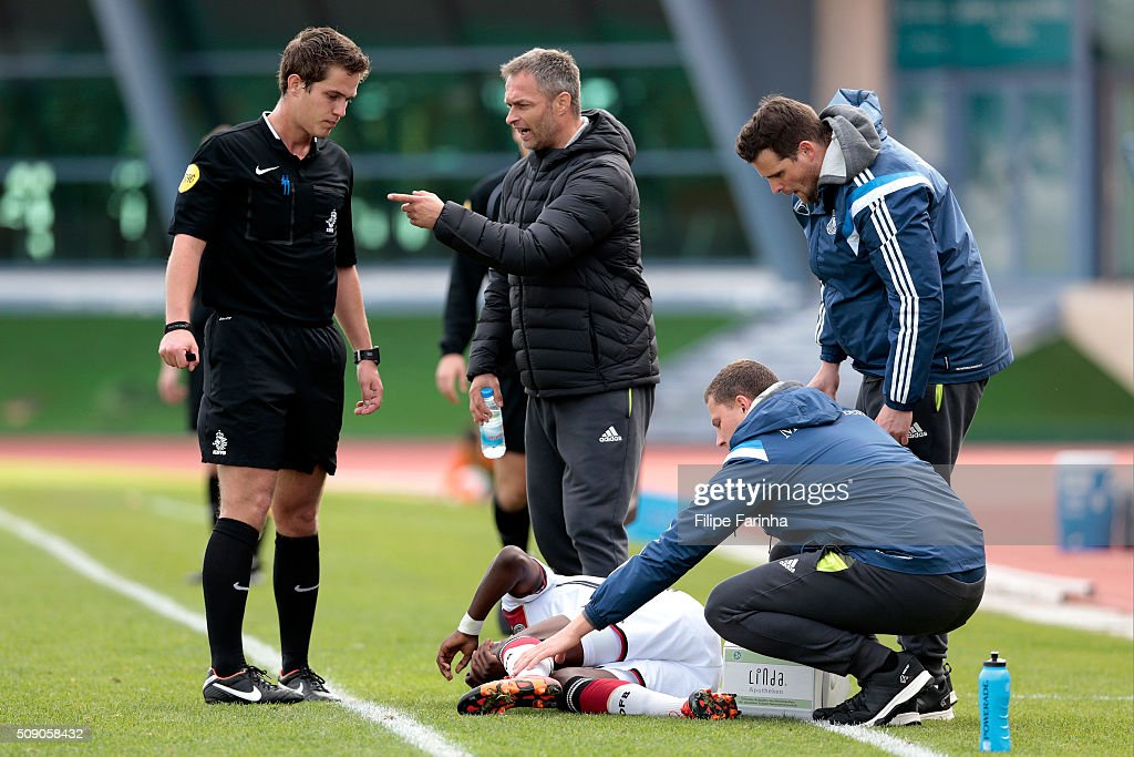 Christian Wuck, coach of Germany argues with the referee while Charles-Jesaja Herrmann is down injured during the UEFA Under16 match between U16 Germany v U16 Netherlands on February 8, 2016 in Vila Real de Santo Antonio, Portugal. (Photo by Filipe Farinha/Bongarts/Getty Images