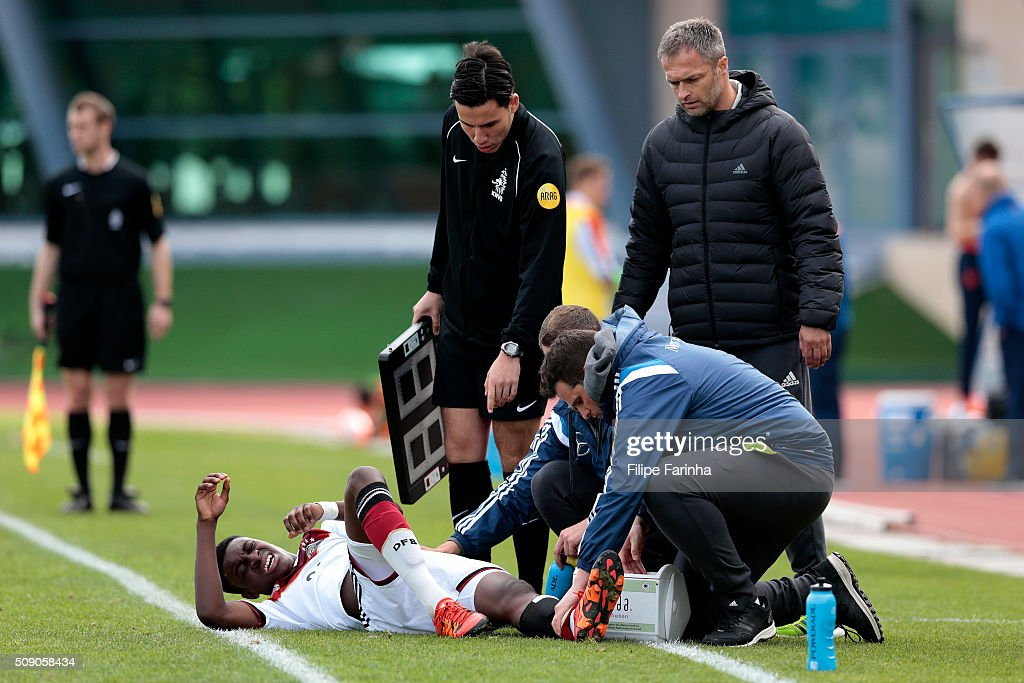 Christian Wuck, coach of Germany observes Charles-Jesaja Herrmann down injured during the UEFA Under16 match between U16 Germany v U16 Netherlands on February 8, 2016 in Vila Real de Santo Antonio, Portugal. (Photo by Filipe Farinha/Bongarts/Getty Images