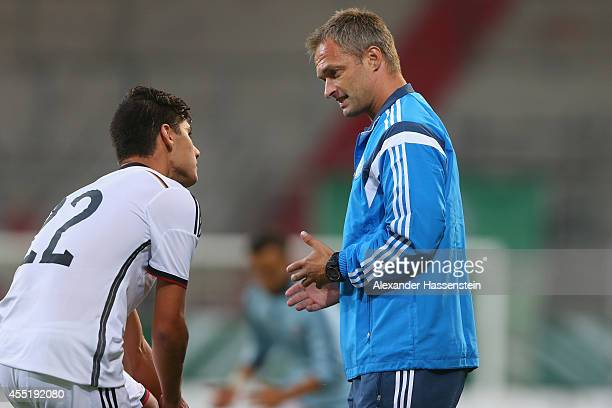 Christian Wueck head coach of Germany talks to his player Goerkem Saglam during the KOMM MIT tournament match between U17 Germany and U17 Netherlands...