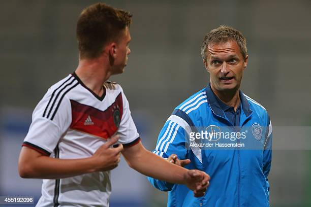 Christian Wueck head coach of Germany talks to his player Jonas Busam during the KOMM MIT tournament match between U17 Germany and U17 Netherlands at...