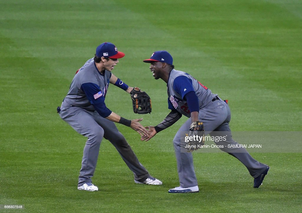 Christian Yelich #7 and Andrew McCutchen #22 of team United States celebrate their 2-1 win in the ninth inning against team Japan during Game 2 of the Championship Round of the 2017 World Baseball Classic at Dodger Stadium on March 21, 2017 in Los Angeles, California.