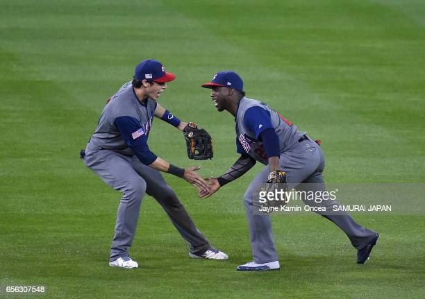 Christian Yelich and Andrew McCutchen of team United States celebrate their 21 win in the ninth inning against team Japan during Game 2 of the...
