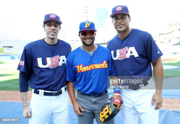 Christian Yelich of Team USA Martin Prado of Team Venezuela and Giancarlo Stanton of Team USA pose for a photo before Game 2 of Pool F of the 2017...