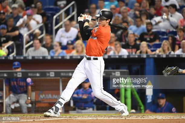 Christian Yelich of the Miami Marlins bats during a MLB game against the New York Mets at Marlins Park on April 16 2017 in Miami Florida