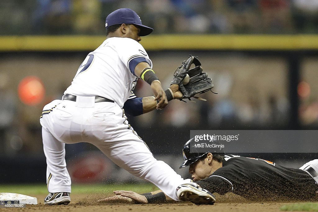 <a gi-track='captionPersonalityLinkClicked' href=/galleries/search?phrase=Christian+Yelich&family=editorial&specificpeople=9527291 ng-click='$event.stopPropagation()'>Christian Yelich</a> #21 of the Miami Marlins beats the throw to <a gi-track='captionPersonalityLinkClicked' href=/galleries/search?phrase=Jean+Segura&family=editorial&specificpeople=7521808 ng-click='$event.stopPropagation()'>Jean Segura</a> #9 of the Milwaukee Brewers while stealing second base in the top of the third inning at Miller Park on September 09, 2014 in Milwaukee, Wisconsin.