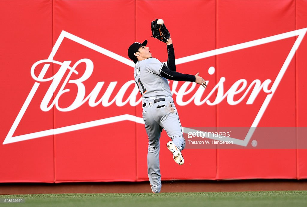 <a gi-track='captionPersonalityLinkClicked' href=/galleries/search?phrase=Christian+Yelich&family=editorial&specificpeople=9527291 ng-click='$event.stopPropagation()'>Christian Yelich</a> #21 of the Miami Marlins catches this fly ball off the bat of Brandon Belt #9 of the San Francisco Giants in the bottom of the first inning at AT&T Park on April 23, 2016 in San Francisco, California. Joe Panik #12 scored on the sacrifice fly.